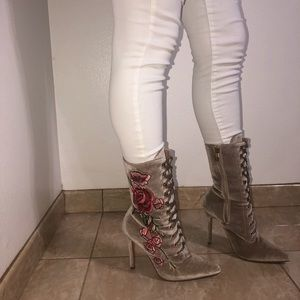 Sued heeled combat boots with flower detailing